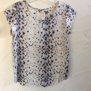 This is a 100% Silk JOIE Animal Print Top.